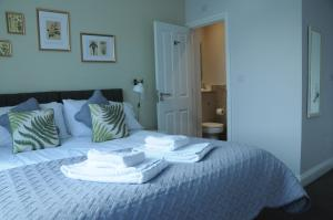 A bed or beds in a room at The Milford Arms