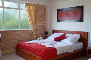 Кровать или кровати в номере Hostería Fundadores