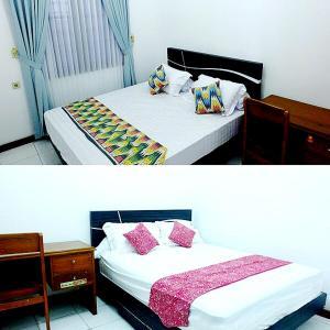 Tempat tidur dalam kamar di City Stay Homestay Jogja