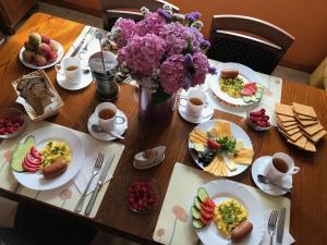 Breakfast options available to guests at Gusarskiy Hotel and Apartment