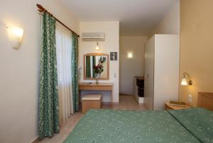 A bed or beds in a room at Alonia Studios & Maisonettes
