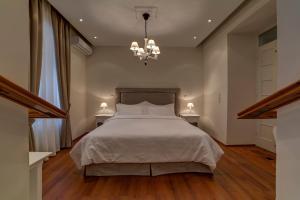 מיטה או מיטות בחדר ב-Home and Poetry