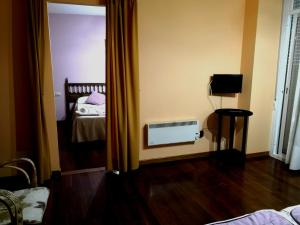 A bed or beds in a room at Residencia Derby