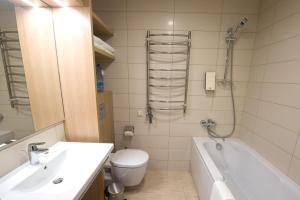 Een badkamer bij Amberton Green Apartments Palanga