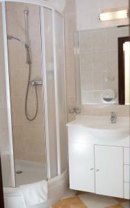 Ein Badezimmer in der Unterkunft Hotel Amalia