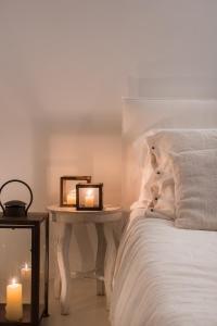 Letto o letti in una camera di Dimora Cala del Pozzo
