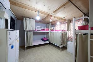 A bunk bed or bunk beds in a room at Hongdae Lazy Fox Hostel in Seoul