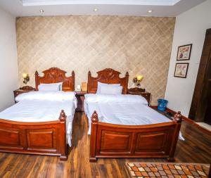 A bed or beds in a room at VIP House