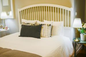 A bed or beds in a room at Casa Conforto