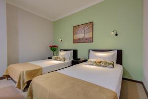 Кровать или кровати в номере Olive Hotel Bishkek