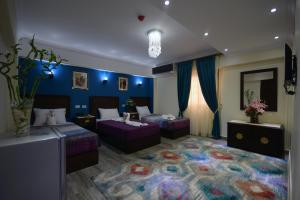 A bed or beds in a room at Amin Hotel