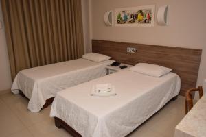 A bed or beds in a room at Hotel Gramado de Campos