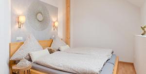 Ein Bett oder Betten in einem Zimmer der Unterkunft Am Quittenbaum