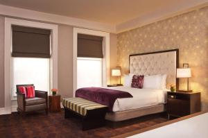 A bed or beds in a room at The Bellevue Hotel, in the Unbound Collection by Hyatt