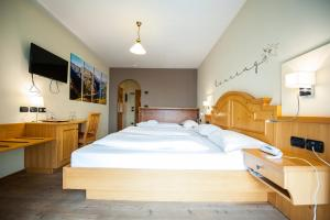 Postel nebo postele na pokoji v ubytování Hotel Touring
