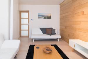 Ein Sitzbereich in der Unterkunft Duplex