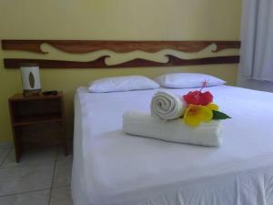 Cama ou camas em um quarto em Aptos do Pinguim
