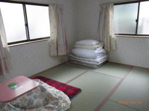 A bed or beds in a room at Oyajino Umi