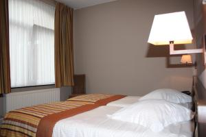 Кровать или кровати в номере Hotel Giorgi