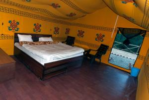 A bed or beds in a room at Jungle Stays