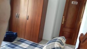 Łóżko lub łóżka w pokoju w obiekcie Neptuno Rooms