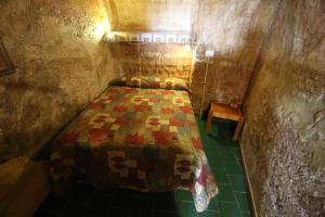 A bed or beds in a room at The Underground Motel