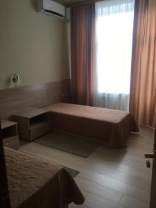 Кровать или кровати в номере Hotel Sokol