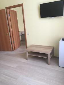 Телевизор и/или развлекательный центр в Hotel Sokol