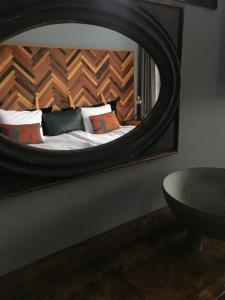A bed or beds in a room at Slipens Hotell