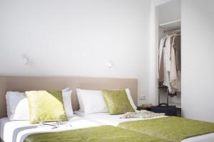 Un ou plusieurs lits dans un hébergement de l'établissement Apartamentos El Guarapo