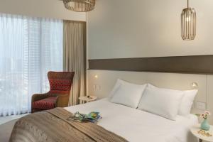Een bed of bedden in een kamer bij Hotel Rothschild 22