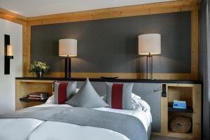 Letto o letti in una camera di Park Gstaad