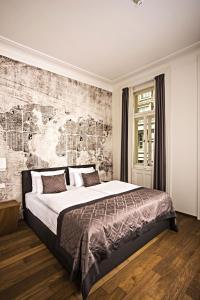 Letto o letti in una camera di Hotel Golden Crown