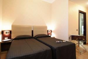 A bed or beds in a room at Euro House Rome Airport