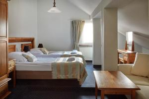 A bed or beds in a room at Rezydencja Solei Old Town