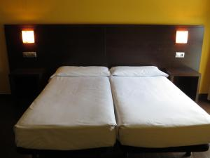 A bed or beds in a room at Euba Hotel