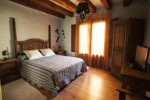 Cama o camas de una habitación en El Rincón de las Hoces del Duratón