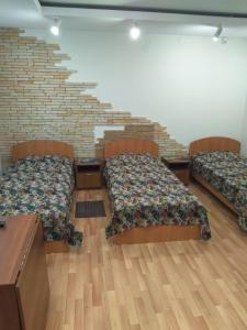 Кровать или кровати в номере Отель Эспланада