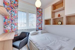 Łóżko lub łóżka w pokoju w obiekcie Rent a Flat - Korzeniowskiego st.