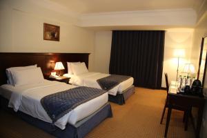 Cama ou camas em um quarto em Tulip Inn Riyadh