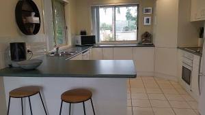 A kitchen or kitchenette at Nambucca Beach House