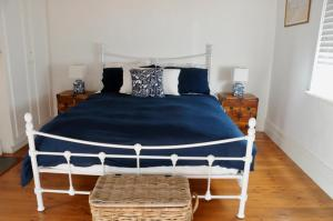 A bed or beds in a room at Kilparney House