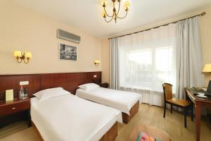 A bed or beds in a room at Hotel Parus