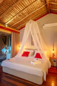 A bed or beds in a room at Secret Garden Beach Resort