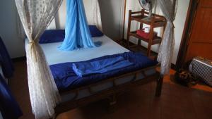 Ein Bett oder Betten in einem Zimmer der Unterkunft Mut Mee Garden Guest House