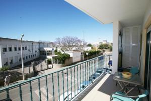 A balcony or terrace at Alvor Sweet Apartment