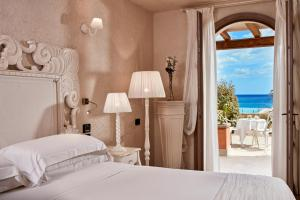 A bed or beds in a room at La Villa Del Re - Adults Only - Small Luxury Hotels of the World