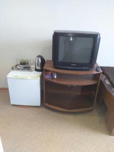 Телевизор и/или развлекательный центр в Отель Эспланада