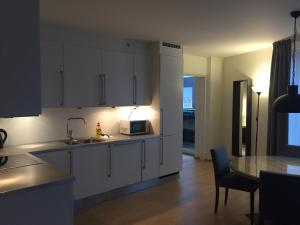 A kitchen or kitchenette at The Apartments Company - Aker Brygge
