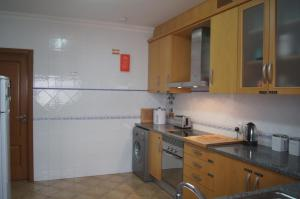 Una cocina o zona de cocina en Aloha Burgau Guesthouse
